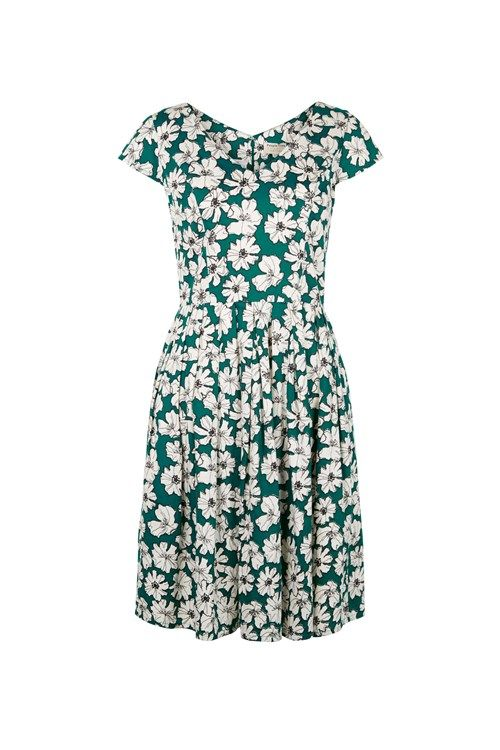 Green woven flared dress with floral print in 100% organic certified cotton. Knee length V-neck with capped sleeves and invisible back zip fastening. Length 97cm.