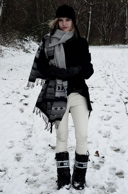 e80e38fd10ef I must get a pair of these moon boots. Her scarf game is on point too!