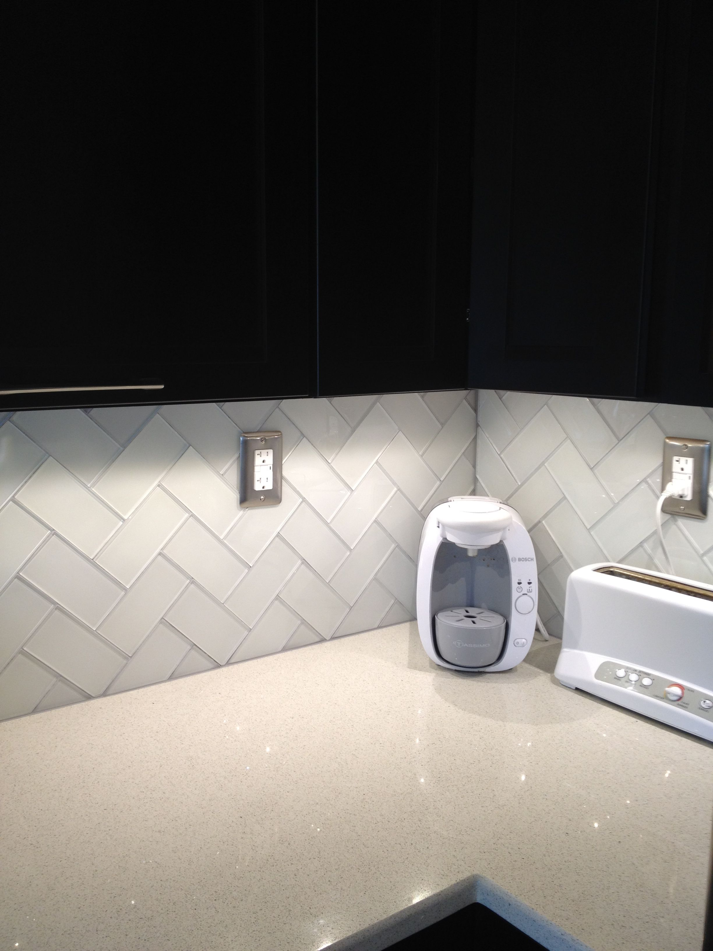 Frosted white glass subway tile also grey grout herringbone pattern br