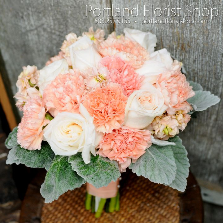 white ohara garden roses, lizzy peach carnations, and peach stock