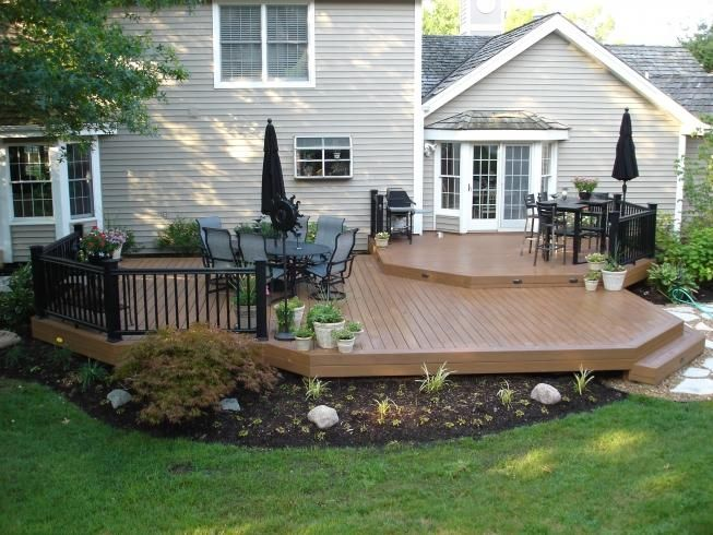 After ground level timbertech deck with timbertech for Deck designs for small backyards