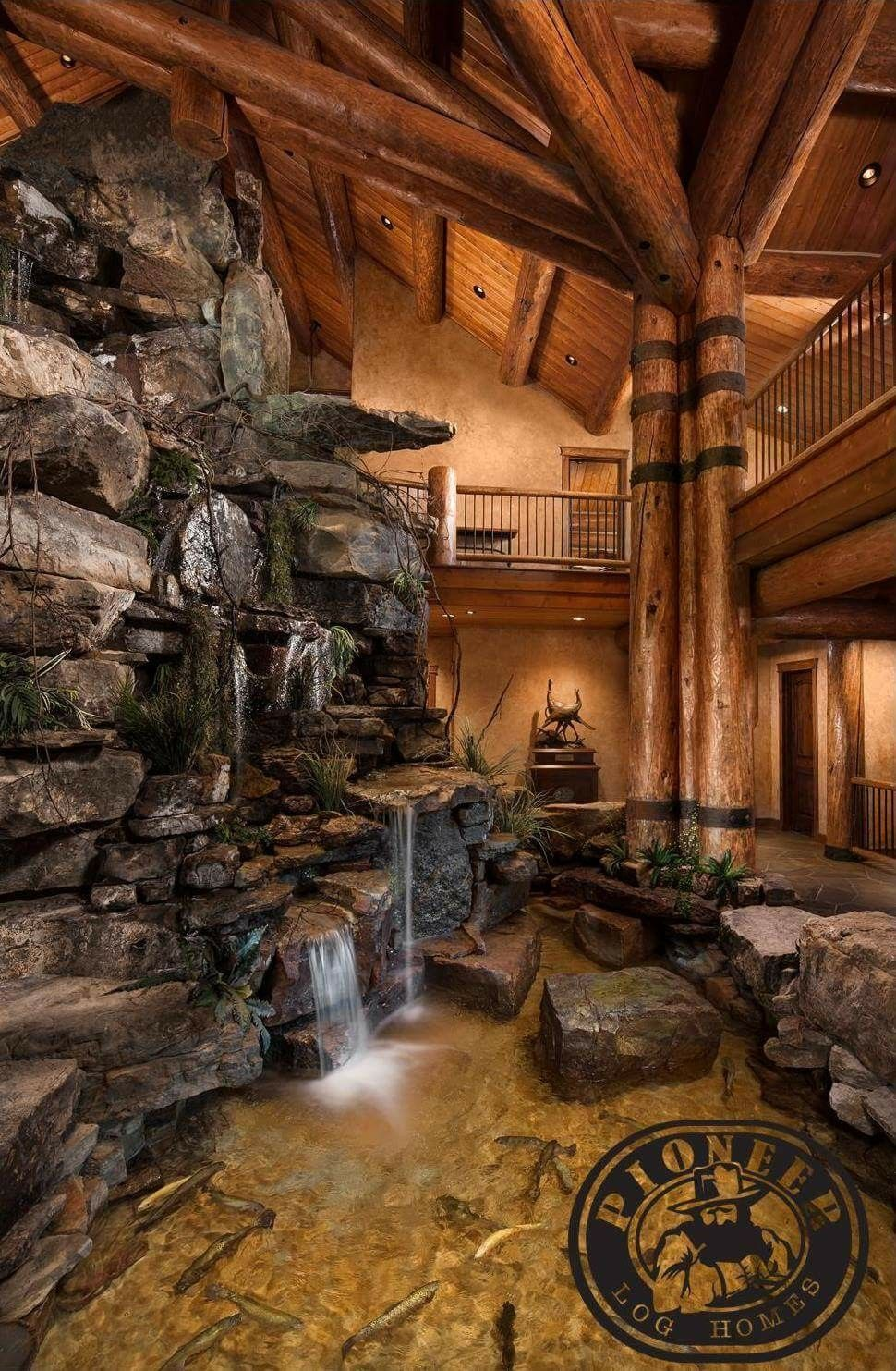 Log Home With A Waterfall Inside I Would Wonder About The Damp Issues Though Casas Casa De Madeira