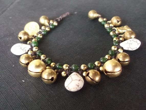 Thai handmade Jingle bell bracelet woven with dark brown wax rope weaved togeter with brass beads jade stone on Etsy, ฿255.10