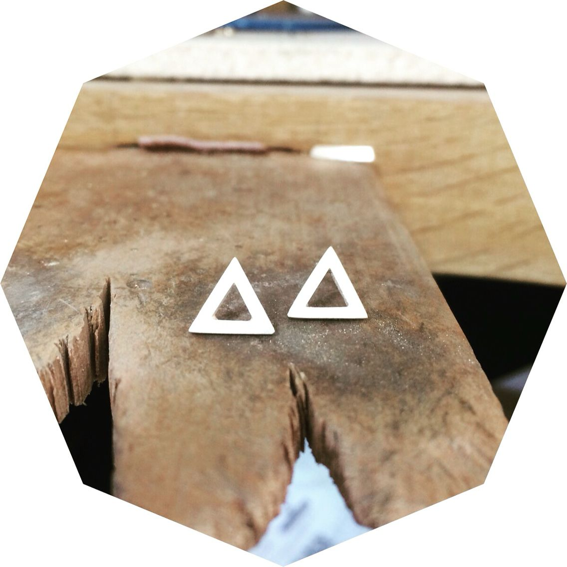 Geometric triangle studs. Handmade by Emma Turpin from silver.