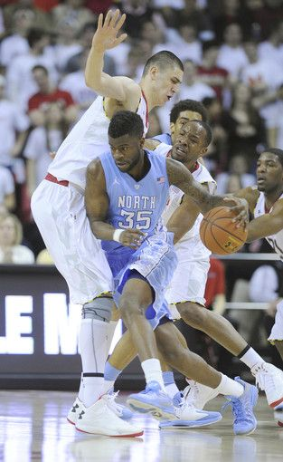 Alex Len and Dez Wells try to stop North Carolina's Reggie Bullock from getting to the basket.