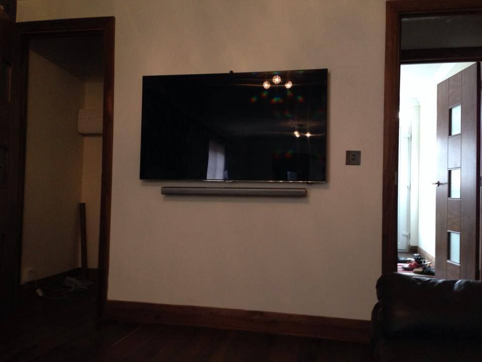 Samsung Tv And Soundbar With Hidden Cables Family Room