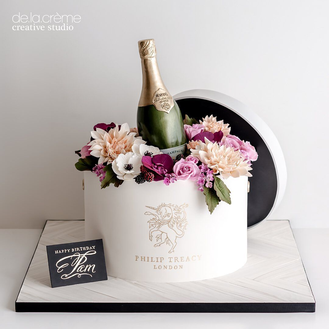 De La Crème Creative Studio S Instagram Profile Post Philip Treacy Hatbox Cake Overflowing With Lush Champagne Cake Design Bottle Cake Cake Designs Birthday