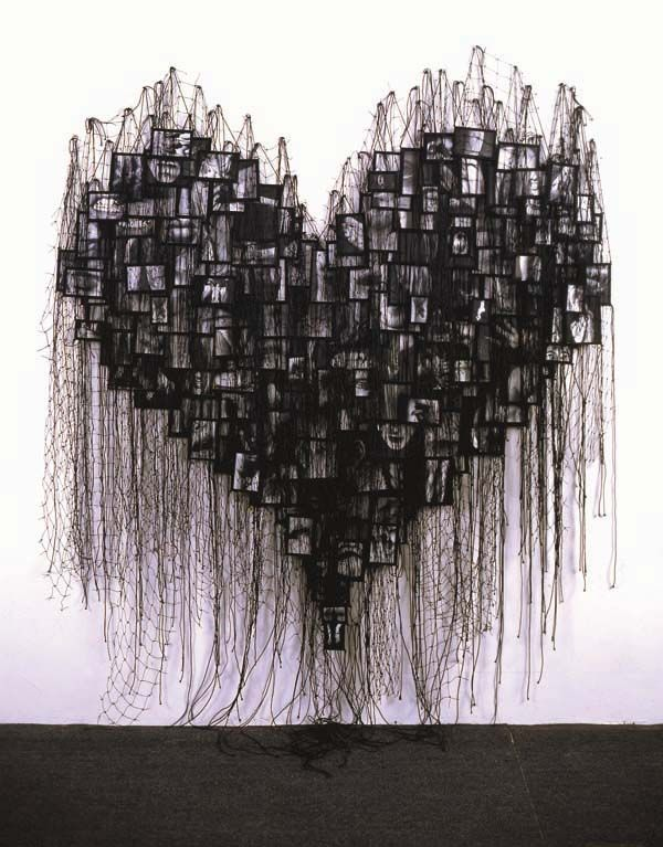 """""""My Trophies""""   Annette Messager -- an installation involving hundreds of photos of parts of the body."""