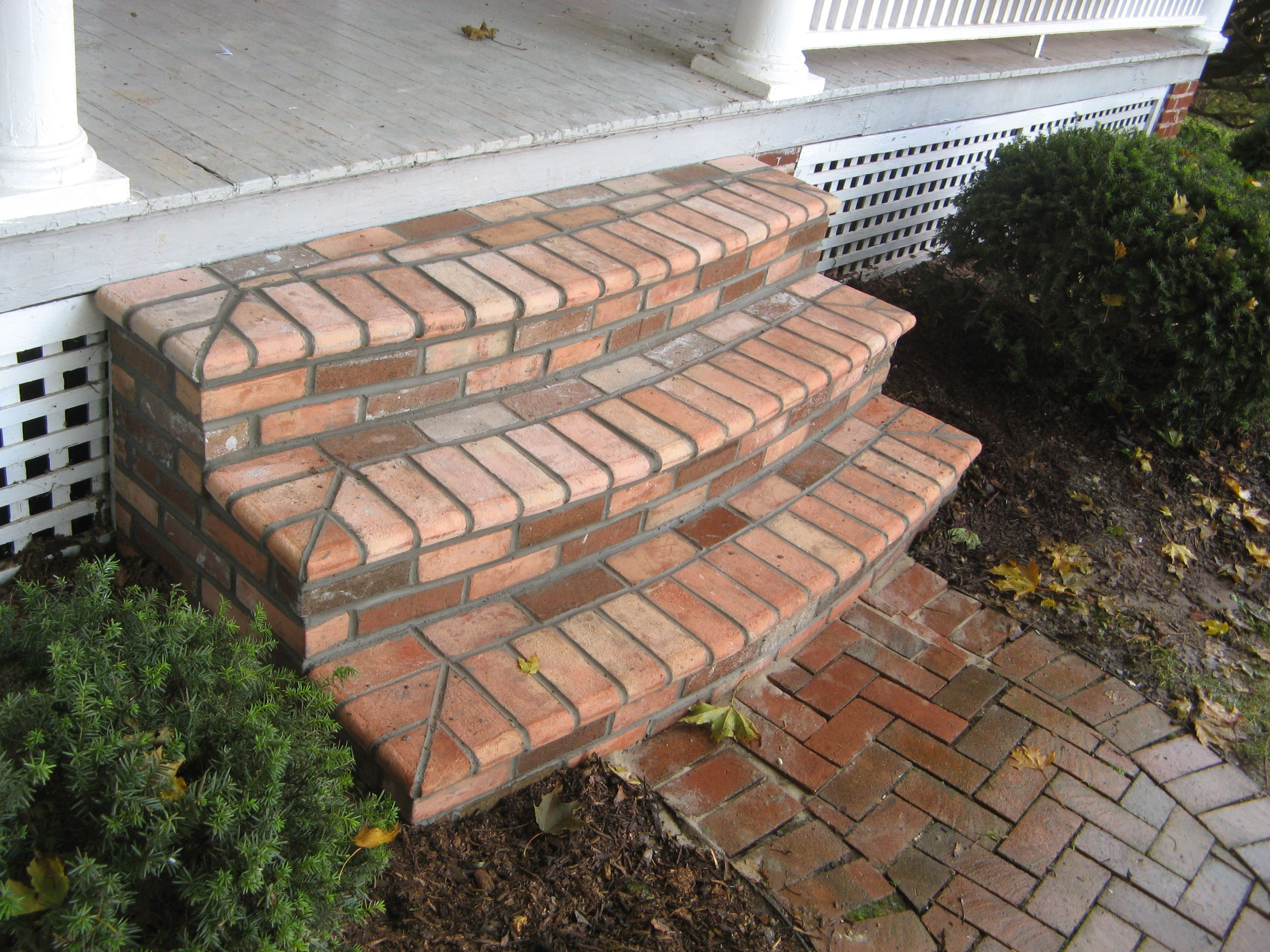 Brick steps elegant curvedstep bullnose porchsteps for Brick steps design ideas