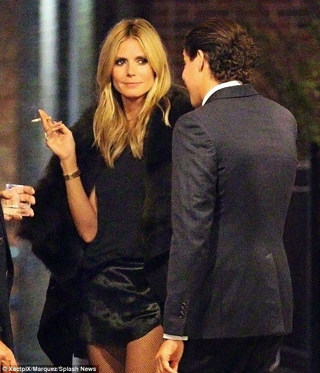 Heidi Klum smoking a cigarette (or weed)
