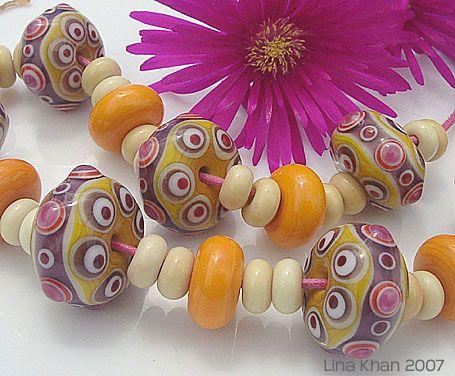 Indish yellow base is richly decorated in white, orange, handpulled yellow, amethyst, rubino oro and dark red.