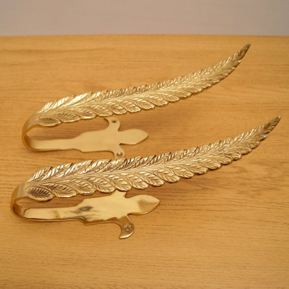 A Pair Of Brass Curtain Hold Backs Feather Design Works Well