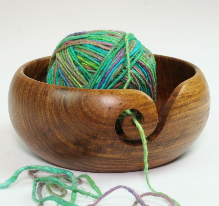 """Handmade Wooden Yarn Bowl. I love how graceful this looks. From Darn Good Yarn """"These wooden yarn bowls are handmade out of Sheesham wood. We work with an amazing co-op in India providing fairtrade, safe jobs for over 600 families. """" Dimensions: Diameter: 4""""  Height: 3"""" affiliate link"""