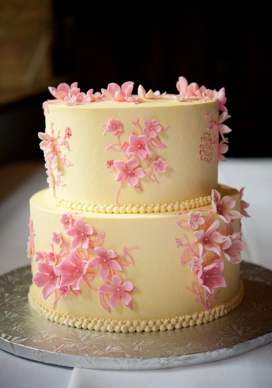 Pale Yellow icing with pretty Pink flowers .. | Incredible Cakes ...
