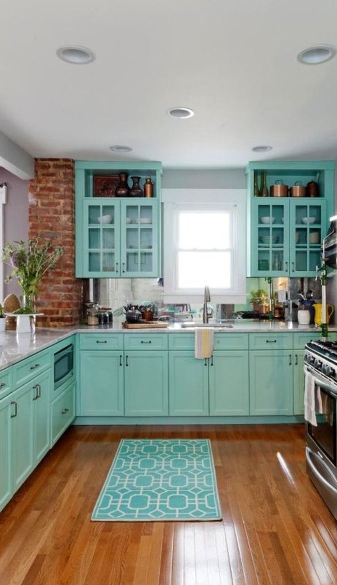 gorgeous tiffany blue kitchen idea. love the brick on the corner