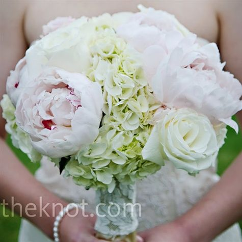 Garden Rose And Peony Bouquet hydrangeas, peonies, and roses. the stems are wrapped with