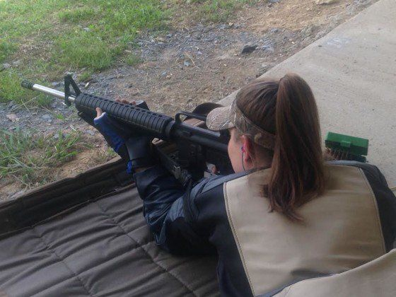 """Teen-aged competition shooter Jules with a her 15-pound competition AR-15, """"Thor."""""""