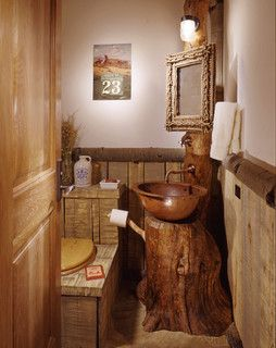 Tree trunk stump for washstand vanity in small bathroom.