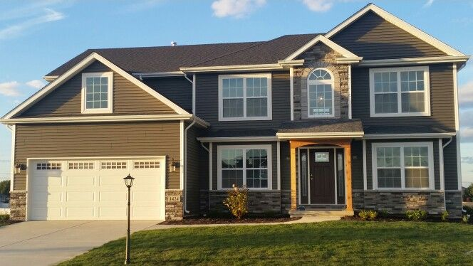 Misty Shadow Vinyl Siding With Rocca Laytite Stone House