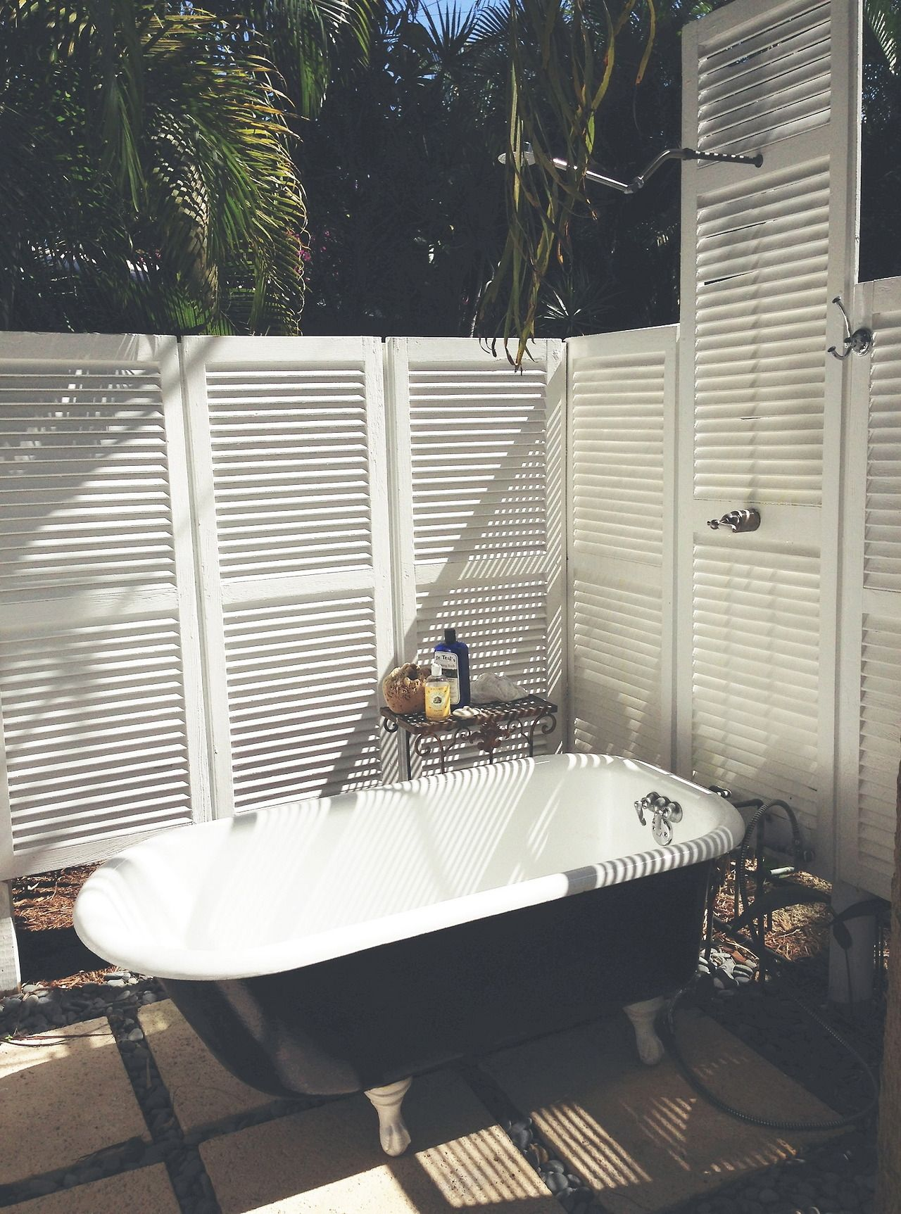 Outdoor tub and shower. I Like the idea of this but not the upkeep ...