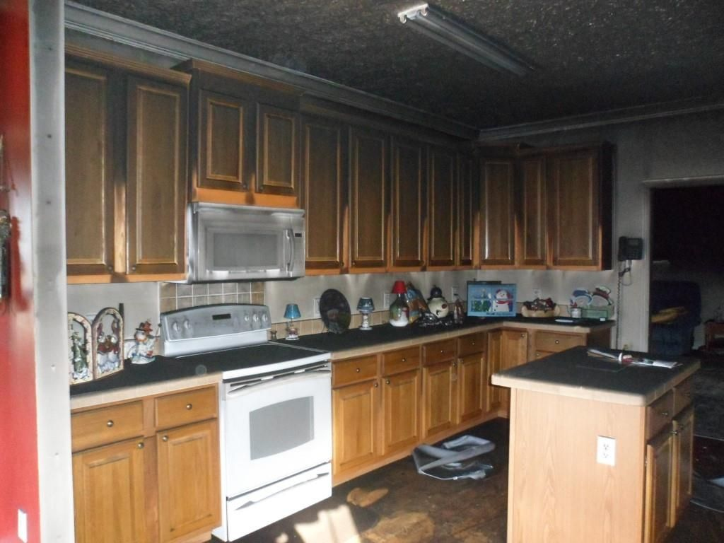 Contact Lindstrom Restoration If You Are Having Any Fire Damage Issue We Are Trained Experienced An Knowledgeable T Fire Damage Water Damaged Ceiling Kitchen
