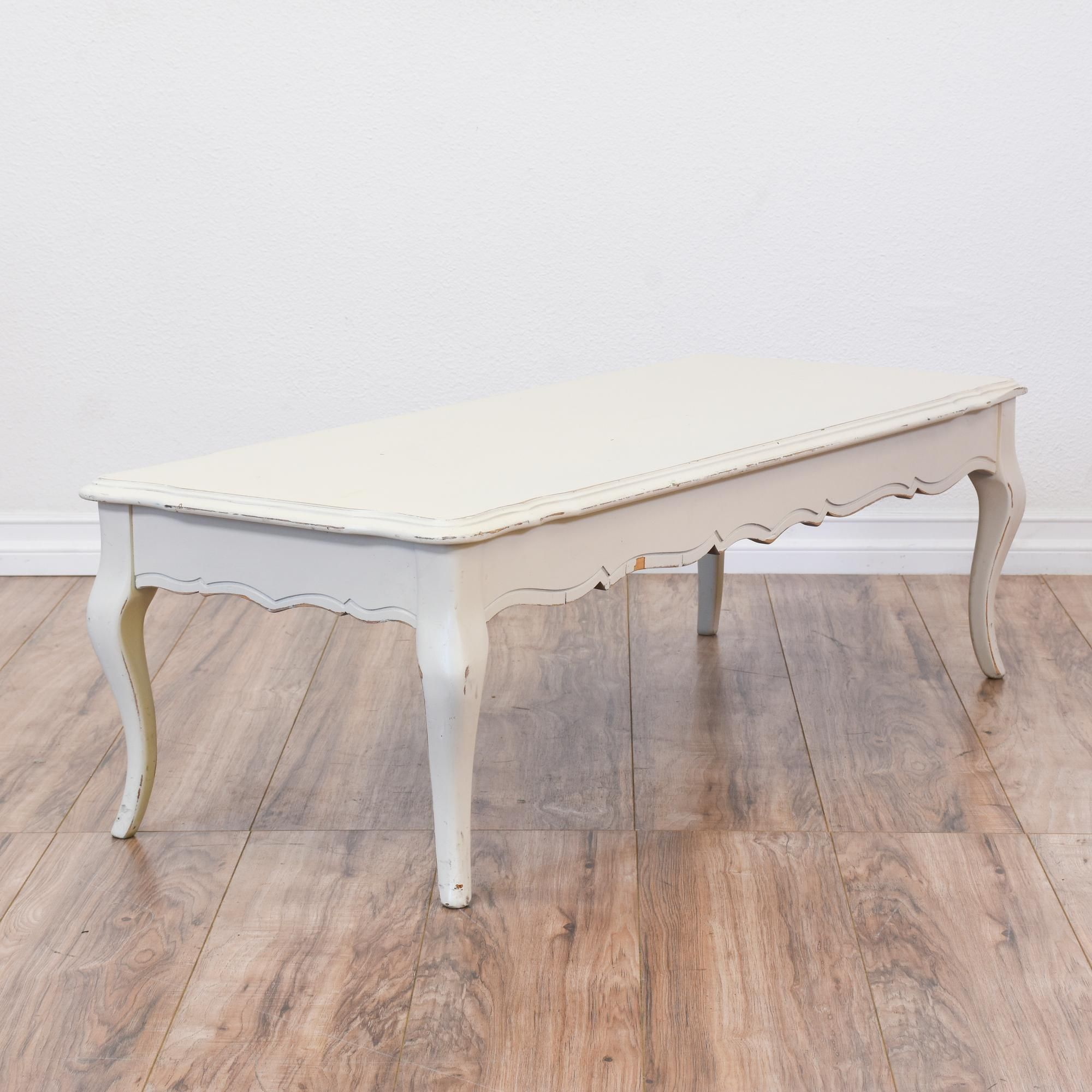 This shabby chic coffee table is featured in a solid wood with a