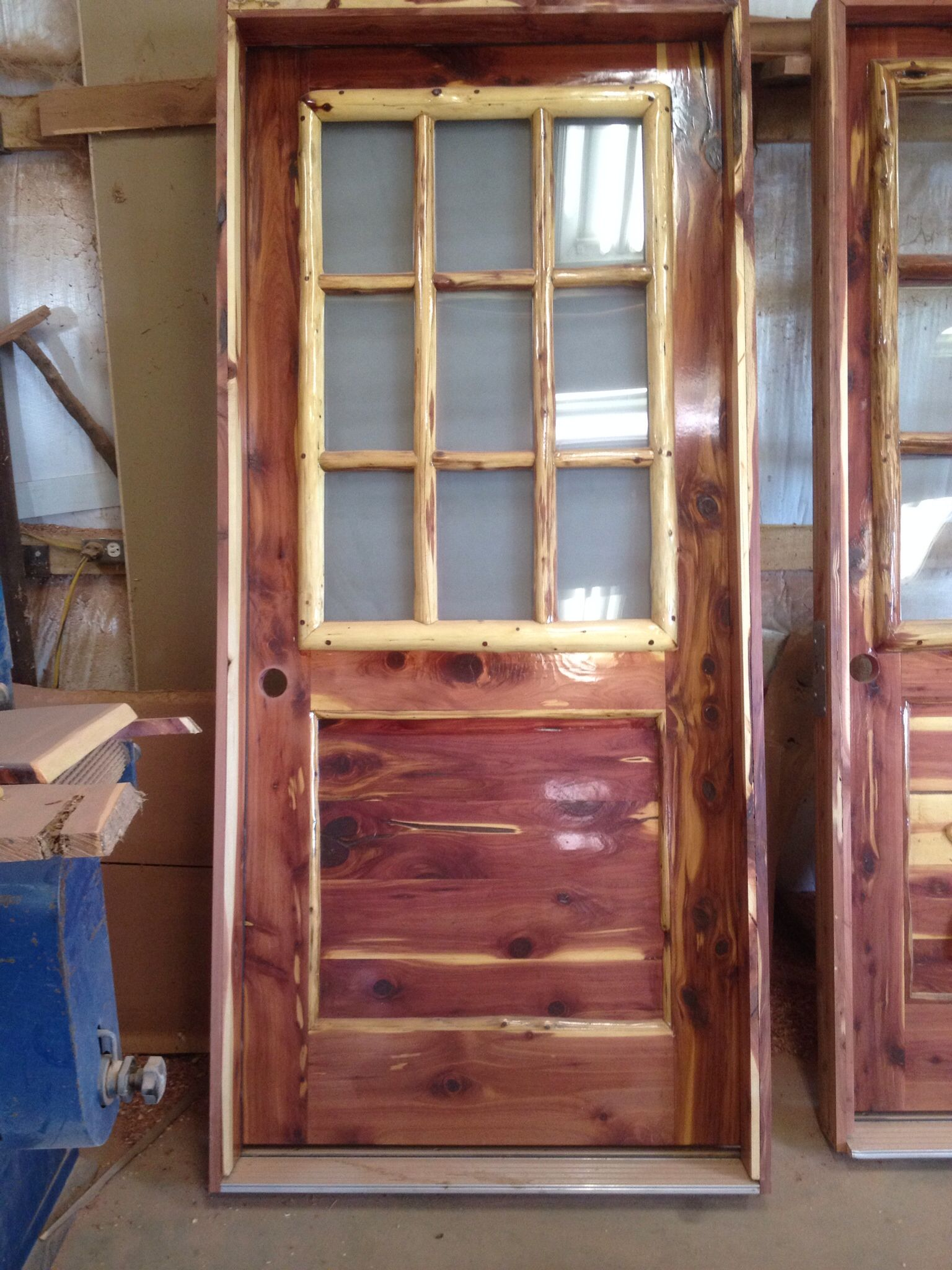 Rustic Red Aromatic Cedar Entry Door With Log Window Frame