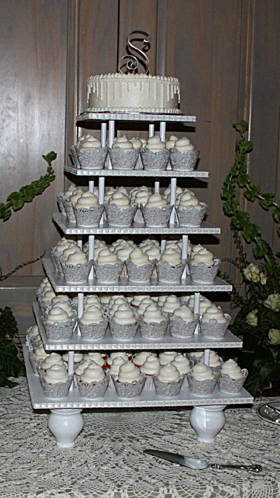 Cupcake stand shown with cupcakes. Very cool!