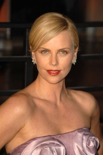 Charlize Theron At Arrivals For Vanity Fair Oscar Party, Sunset Tower Hotel, Los Angeles, Ca March 7, 2010. Photo By: Dee Cercone/Everett Collection Photo Print (8 x 10)