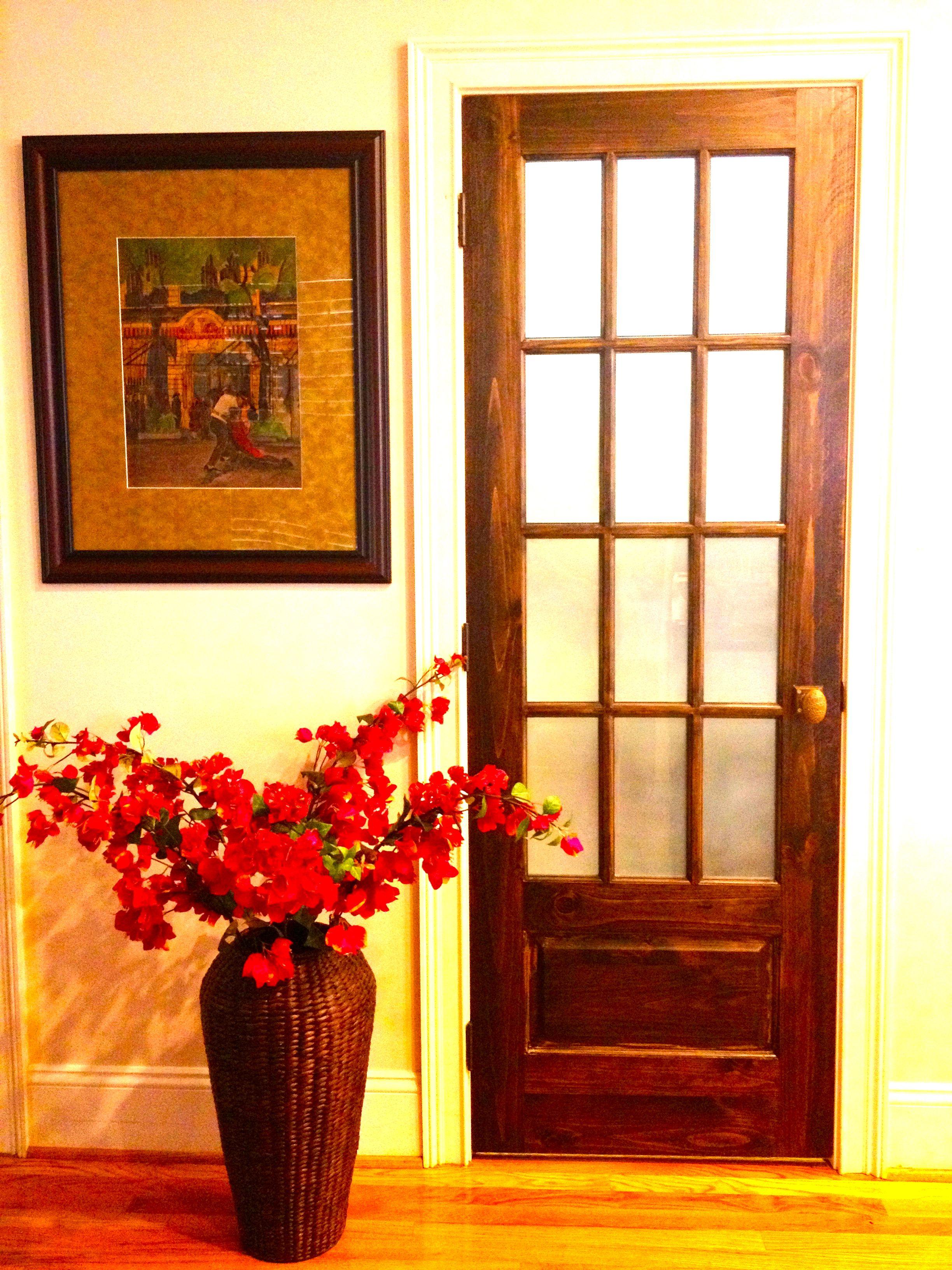 Rustic pantry door with antique nyc public school door knob