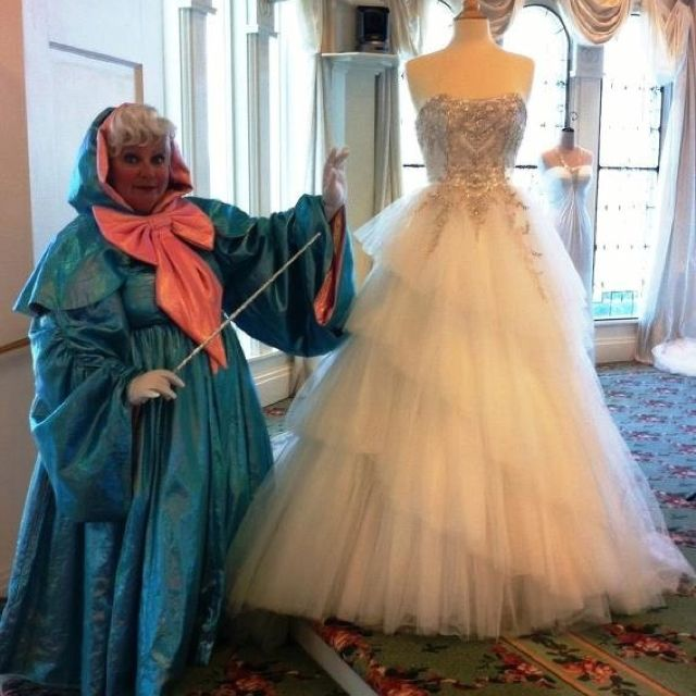 Cinderella 39 s fairy godmother with her wedding dress from for Disney princess cinderella wedding dress