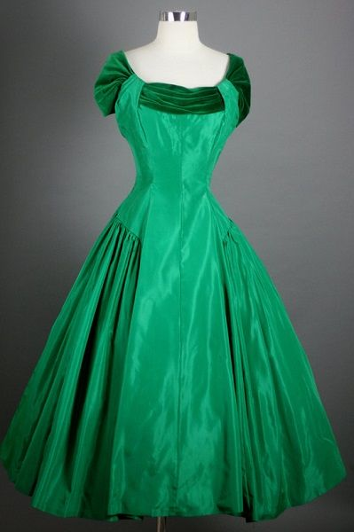 1950's glamorous silhouette taffeta cocktail party dress, with fitted bodice, slightly dropped waistline, full skirt over tulle underskirt.