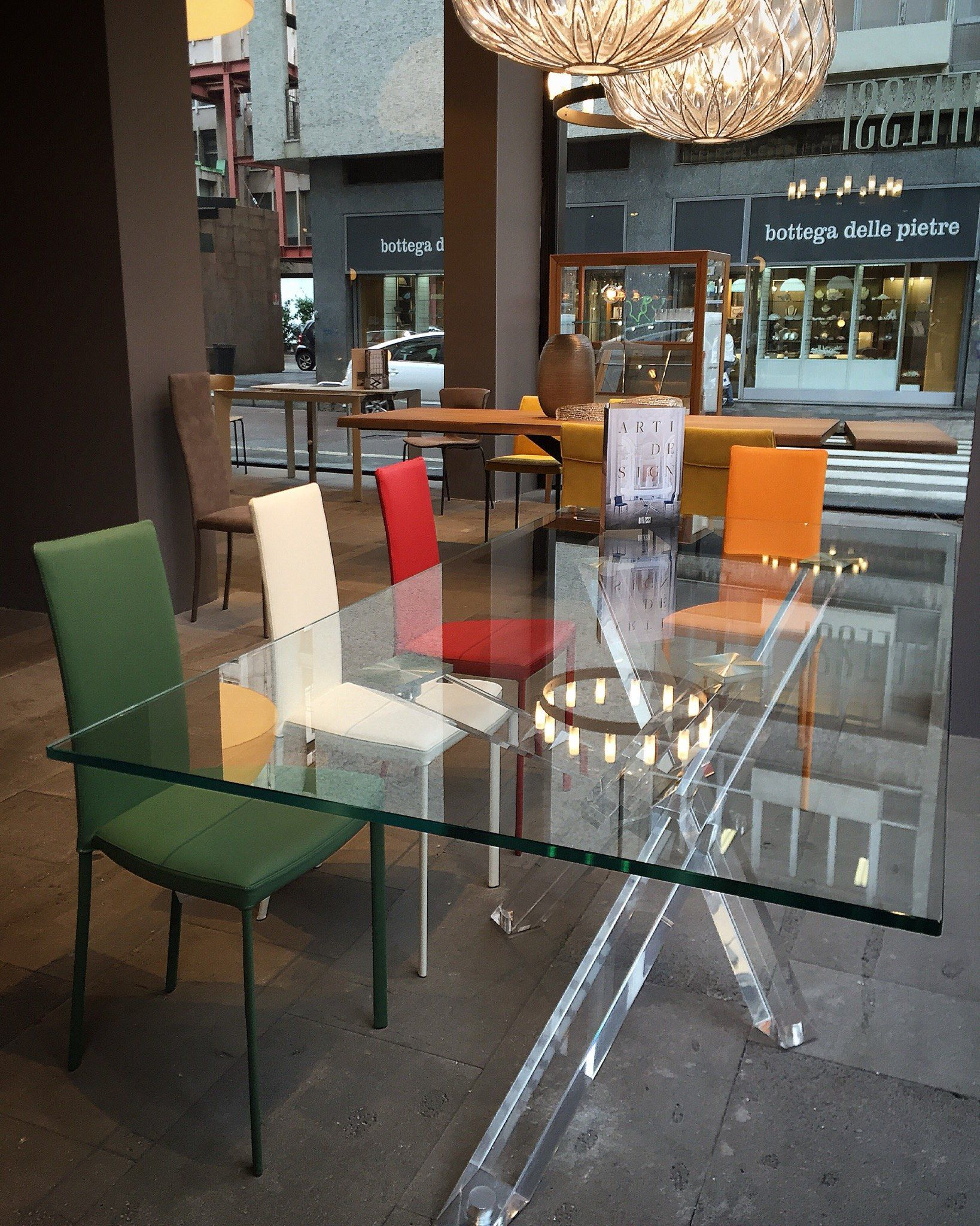 Table Shangai limited edition 100x200 transparent methacrylate base, top in tempered extraclearglass; Chai Slim with steel frame upholstered in eco-leather