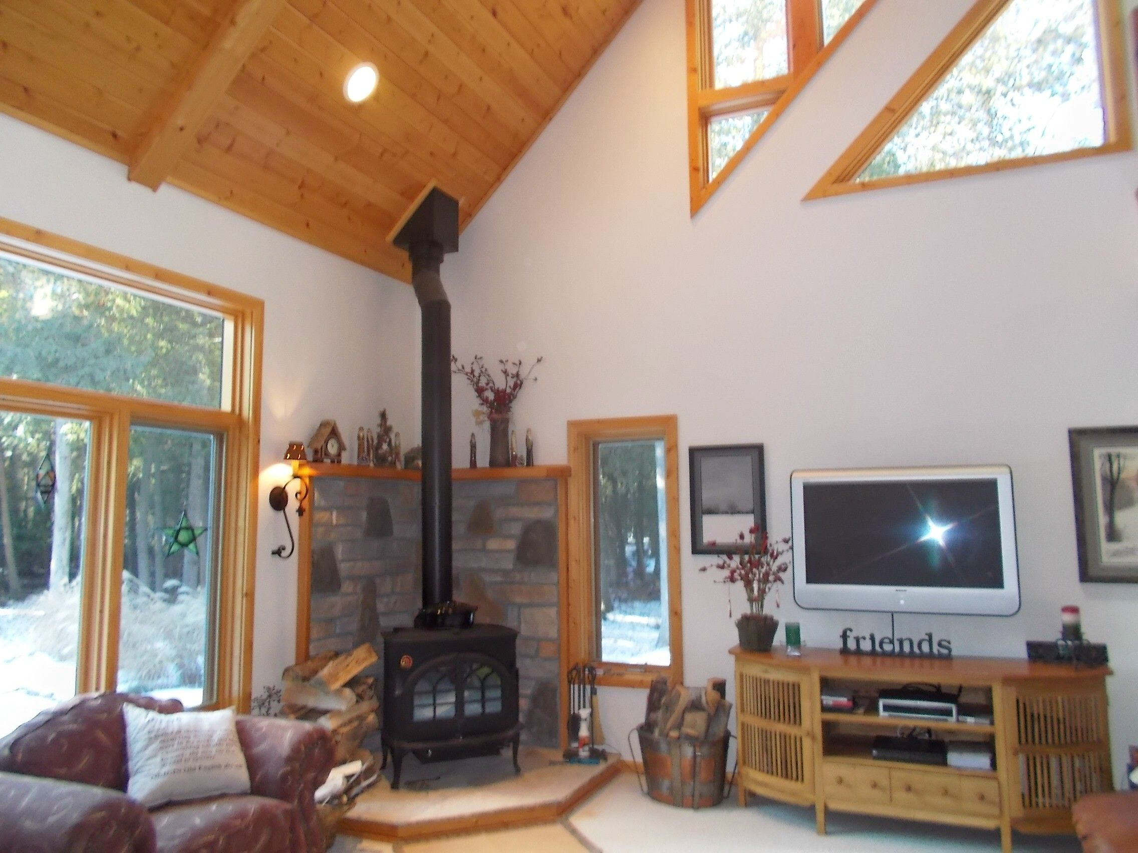 Great Room with Walls of Windows to Wel e in the Woods Cozy