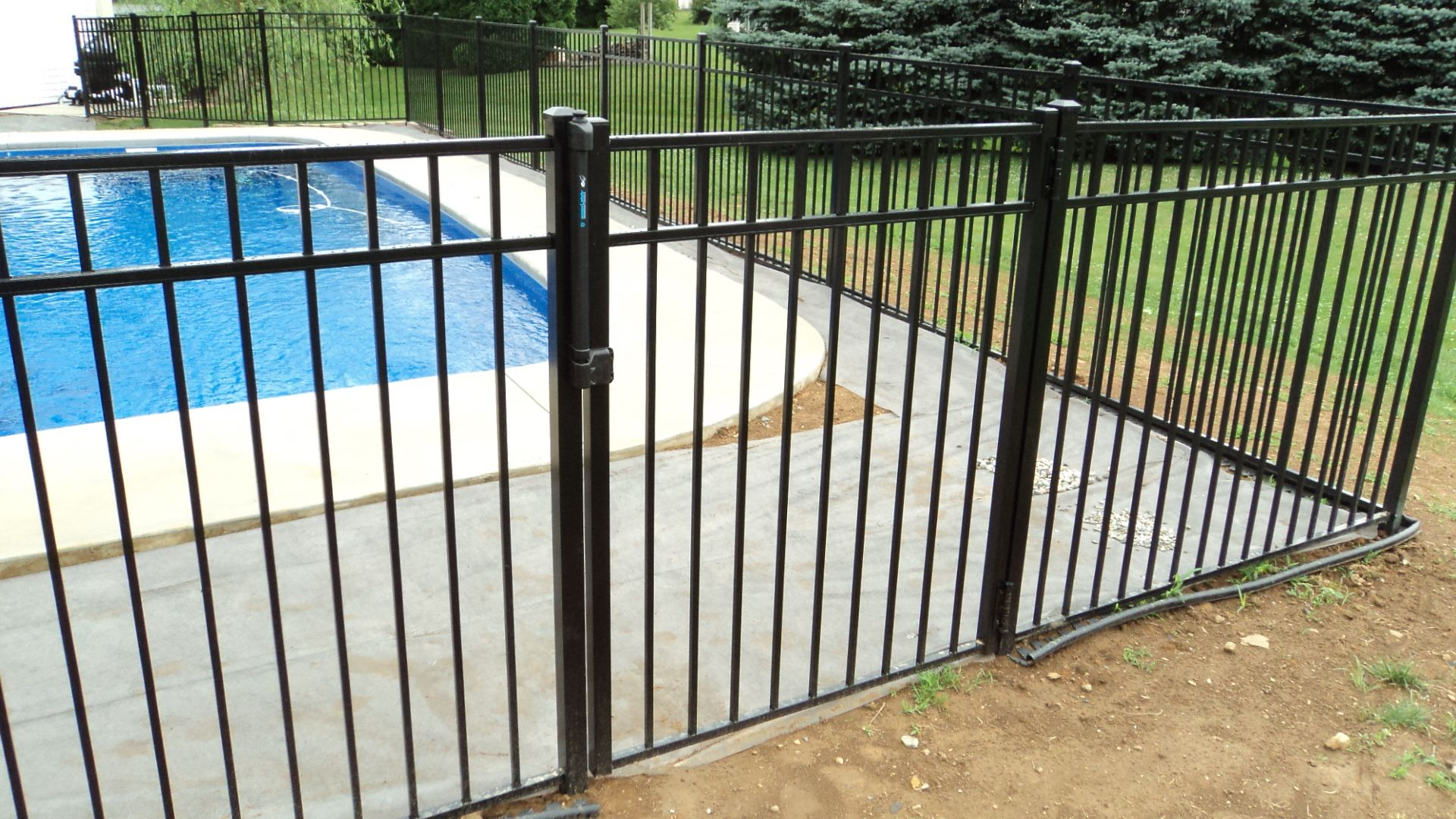23 Important Ways To Keep Your Kids Safe This Summer Pool Safety Fence Pool Safety Fence Around Pool