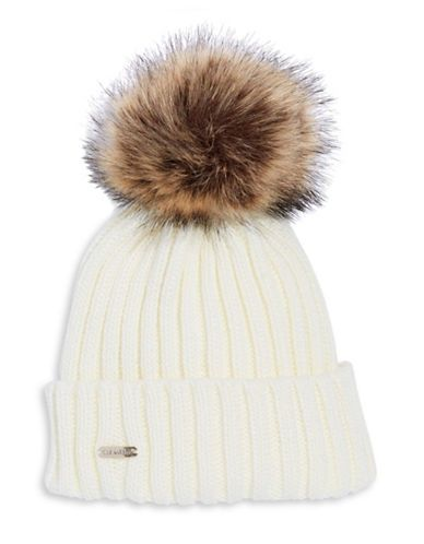 89ee87a3 CALVIN KLEIN Calvin Klein Faux Fur Pom Pom Ribbed Beanie. #calvinklein #