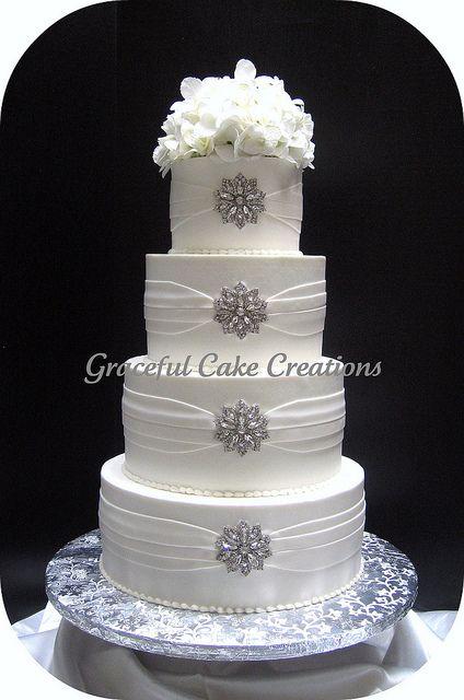 Elegant White Wedding Cake With Silver Brooches Wedding Cakes Bling Wedding Cakes Cake