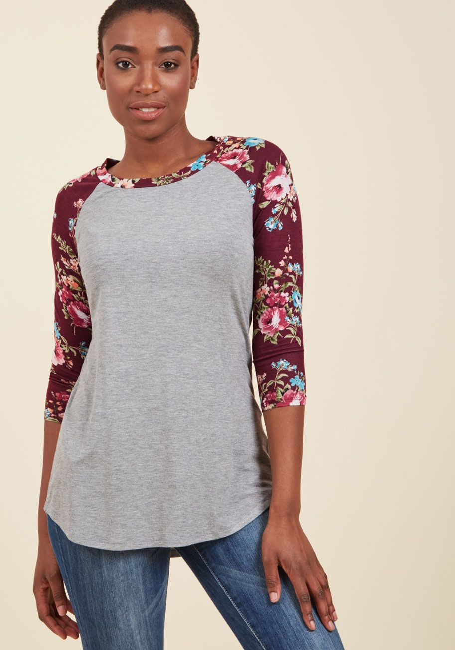 <p>Step up to the plate feeling fresh in this raglan top - a ModCloth exclusive! Turning a triple play with a breezy, heather grey bodice, deep burgundy sleeves, and a warm-toned floral print, this casual tee is as perfect for sipping soda in the dugout as it is for getting in on street style action.</p>