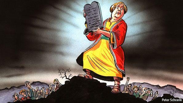 Merkel holding the 10 commandments