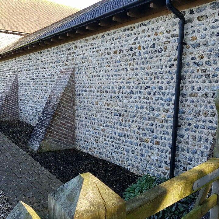 Fieldstone flint wall built in lime mortar built to match ...