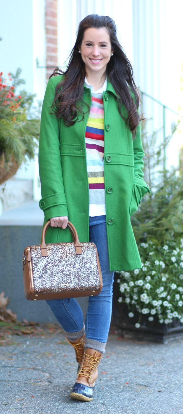 Love this preppy winter outfit idea! Crazy stripe sweater with long green trench coat, light wash jeans, and LLBean boots. So cute and colorful!