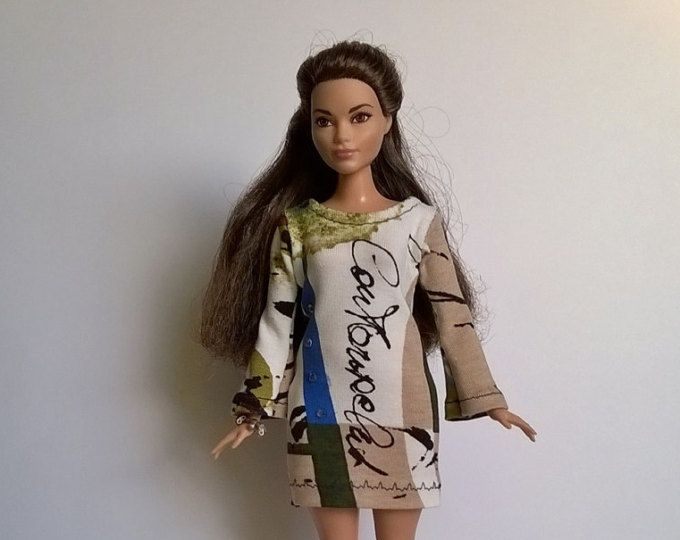 a dress fitting for curvy barbie and similar-sized fashion dolls Colour variations are possible Only the dress without doll and decoration will be delivered NOT FOR CHILDREN UNDER 4 YEARS