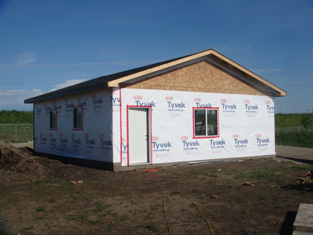 Paper Walls: Every garage is wrapped with Tyvek home wrap