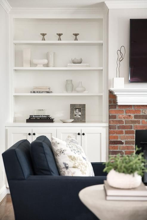 Exquisite Traditional Living Room Boasts A Red Brick Fireplace Finished With A White Mantel Located Und White Brick Fireplace Red Brick Fireplaces White Mantel