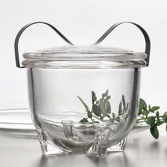 A glass jar for cooking and baking.