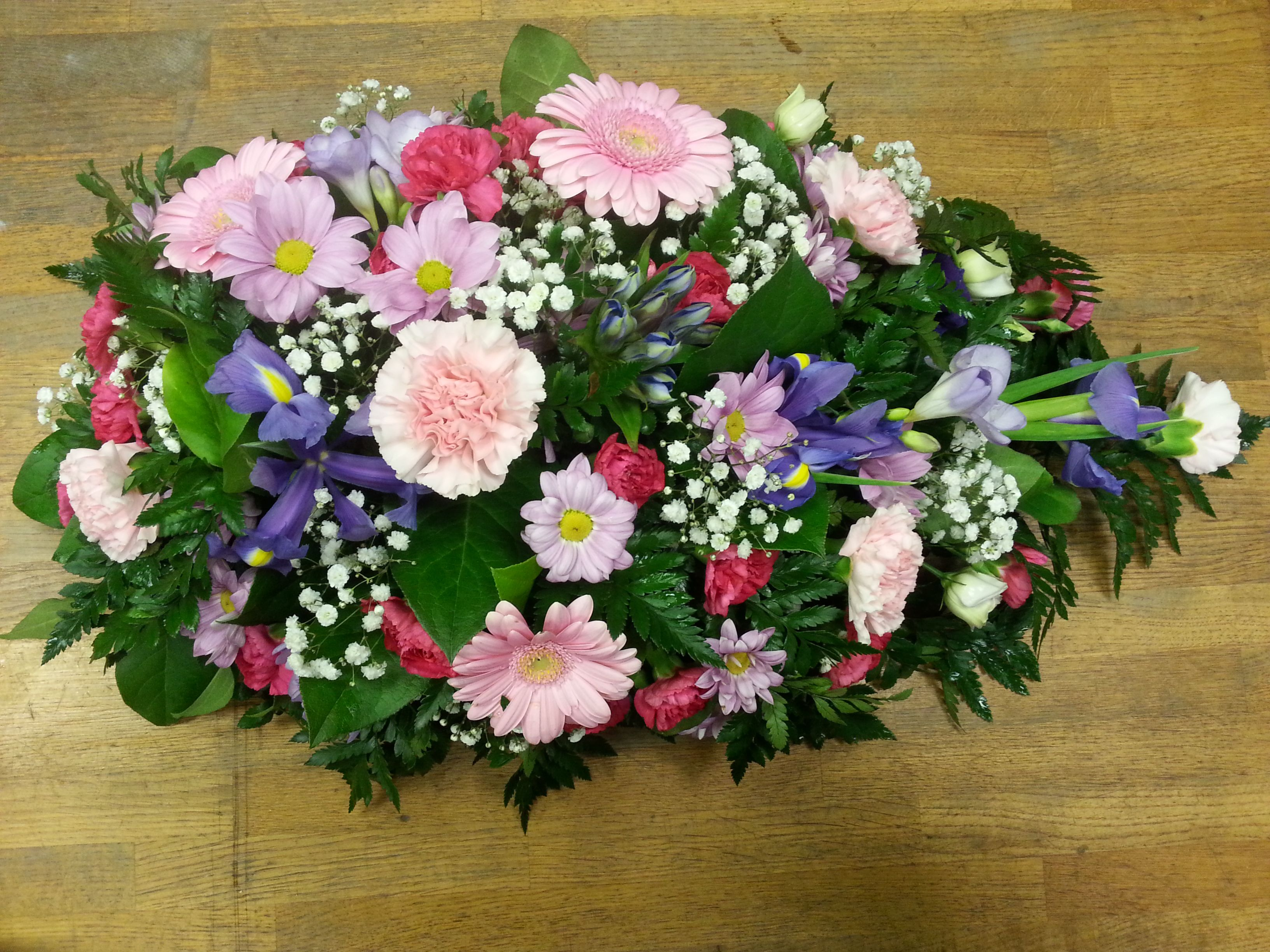 Pretty pink tribute in a teardrop shape as experts in funeral need help selecting flowers for funeral funeral tributes are the perfect way to express emotions order funeral flowers online with us today izmirmasajfo