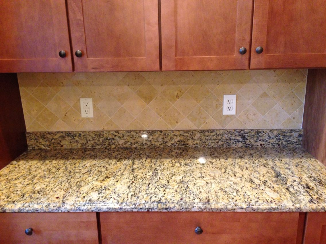 Beautiful limestone backsplash for the person that wants a clean simple look!