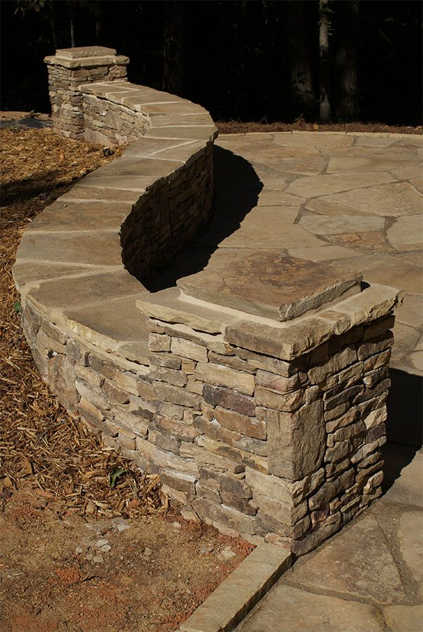 Curved new england fieldstone ledge sitting wall with for Curved garden wall ideas