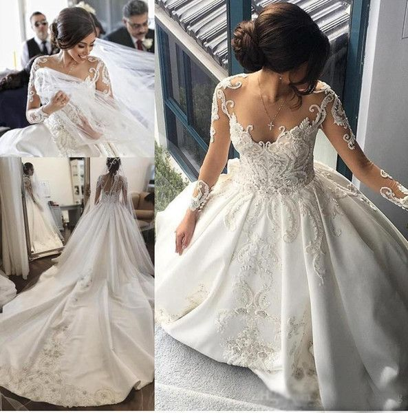 Discount 2018 Sexy Luxury Wedding Dresses A Line Jewel Neck Illusion Long Sleeves Lace Appliques Beaded Cathedral Train Plus Size Formal Bridal Gowns Grecian Style Wedding Dresses Lace Wedding Dresses Vintage From Haiyan4419, $312.22| DHgate.Com #grecianweddingdresses Discount 2018 Sexy Luxury Wedding Dresses A Line Jewel Neck Illusion Long Sleeves Lace Appliques Beaded Cathedral Train Plus Size Formal Bridal Gowns Grecian Style Wedding Dresses Lace Wedding Dresses Vintage From Haiyan4419, $312. #grecianweddingdresses