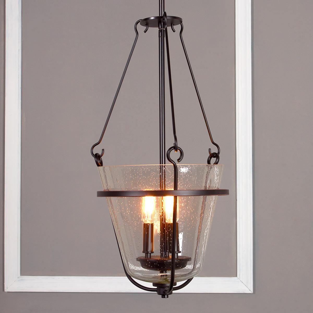 Seeded Glass Lantern This Seeded Glass Bell Lantern Is Cradled In A Deep Rubbed Bronze Frame